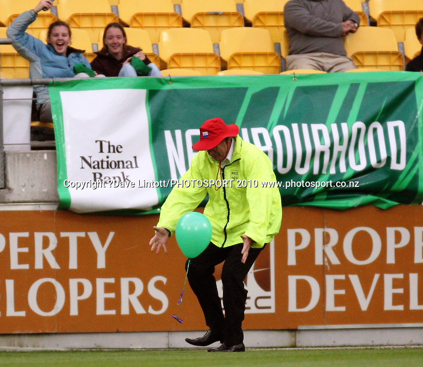 A security guard captures a pitch-invading balloon.<br /> Fifth Chappell-Hadlee Trophy one-day international cricket match - New Zealand v Australia at Westpac Stadium, Wellington. Saturday, 13 March 2010. Photo: Dave Lintott/PHOTOSPORT