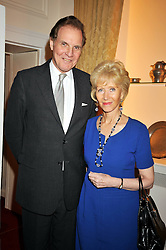 JONATHAN AITKEN and his wife ELIZABETH HARRIS at an exhibition of photographs by Edgar Astaire held at The Royal Hospital Chelsea, London on 24th April 2009.