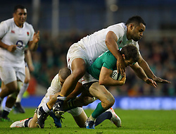 Jared Payne of Ireland is tackled by Billy Vunipola of England and Mike Brown - Mandatory by-line: Ken Sutton/JMP - 18/03/2017 - RUGBY - Aviva Stadium - Dublin,  - Ireland v England - RBS 6 Nations