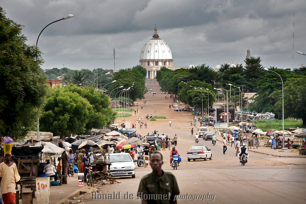 The Basilica of Our Lady of Peace of Yamoussoukro dominates from every point in the city of Yamoussoukro, one of the most unlikely capitals in the world. The Cathedral is the largest in the world, a few m. higher than it's example in Rome. President Fe?lix Houphoue?t-Boigny of Cote d'Ivoire had the cathedral built 20 years ago in his birthplace that he had made capital of the country. Twenty years later Abidjan remains the economical and political capital of the country though.