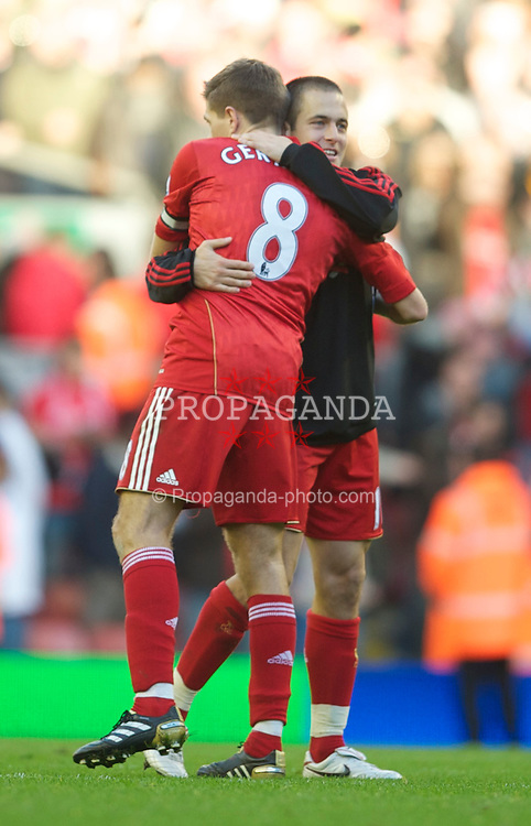 LIVERPOOL, ENGLAND - Sunday, October 24, 2010: Liverpool's Joe Cole and and captain Steven Gerrard MBE celebrate their 2-1 victory over Blackburn Rovers during the Premiership match at Anfield. (Photo by David Rawcliffe/Propaganda)