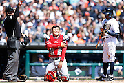 DETROIT, MI - APRIL 19: Hank Conger #16 of the Los Angeles Angels reacts after being struck by the bat of Rajai Davis #20 of the Detroit Tigers during the game at Comerica Park on April 19, 2014 in Detroit, Michigan. The Tigers won 5-2. (Photo by Joe Robbins)
