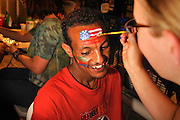 Refugees from around the globe, including a young man from Eritrea on the Horn of Africa, celebrate at Tucson World Refugee Fest 2012, where some received their  citizenship papers in Tucson, Arizona, USA.