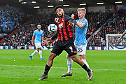 Lys Mousset (9) of AFC Bournemouth battles for possession with Oleksandr Zinchenko (35) of Manchester City during the Premier League match between Bournemouth and Manchester City at the Vitality Stadium, Bournemouth, England on 2 March 2019.