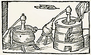 'Distillation: alembics in water baths on furnaces, feed distillate into receivers. Woodcut from ''De la pirotechnia'', Bologna, 1678. First published 1540.'
