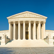 US Supreme Court building on Capitol Hill, Washington DC. High resolution panorama with clear blue sky and evening sunlight.