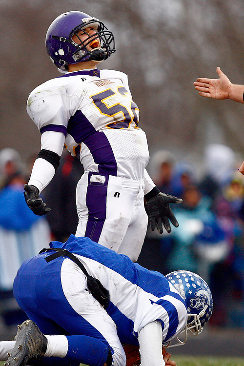 Casey-Westfield's Patrick White (52) lets out a yell after a sack against Auburn's Michael Bates during an IHSA Class 2A semifinal game at Auburn High School's Michael J. Potts Memorial Field Saturday, Nov. 22, 2008, in Auburn, Ill. Casey-Westfield won the game with a score of 27-13 to advance to the state finals.