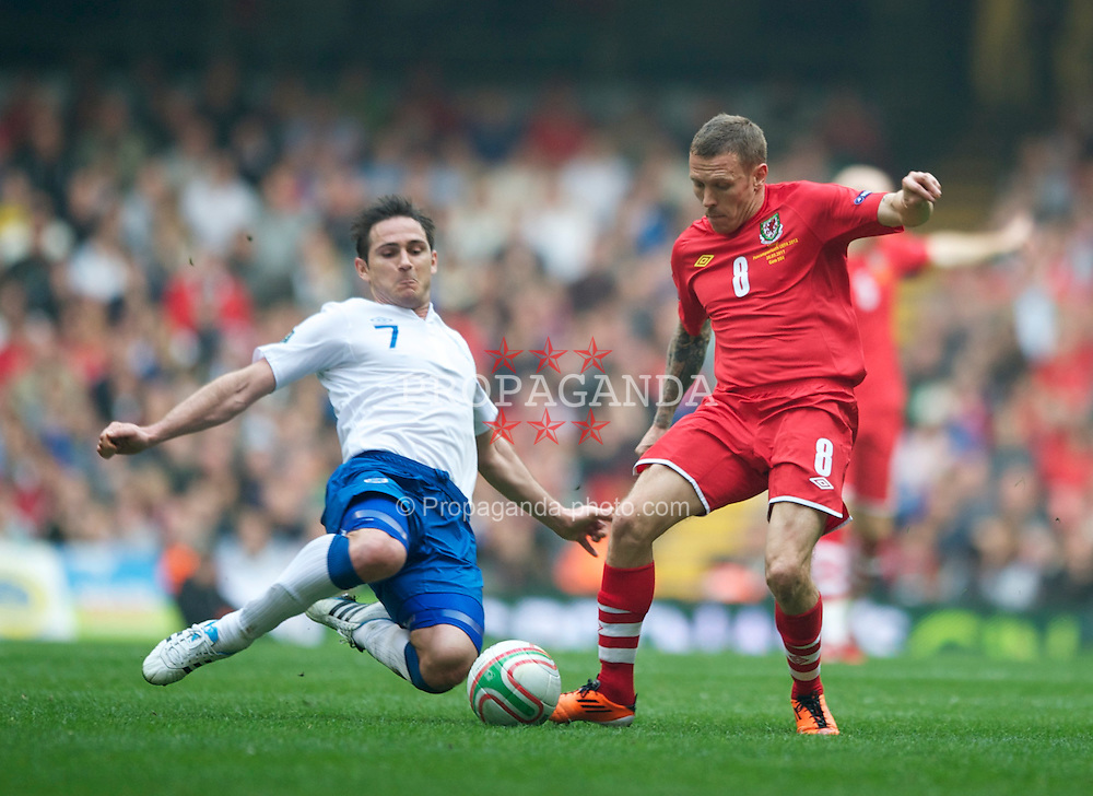 CARDIFF, WALES - Saturday, March 26, 2011: Wales' Craig Bellamy and England's Frank Lampard during the UEFA Euro 2012 qualifying Group G match at the Millennium Stadium. (Photo by Chris Brunskill/Propaganda)
