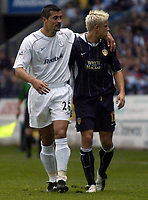 Photo. Glyn Thomas.<br /> Bolton Wanderers v Leeds United. <br /> FA Barclaycard Premiership. 02/05/2004.<br /> Bolton's Emerson Thome (L), who pulled down Alan Smith to give Leeds a penalty consoles his opponent.