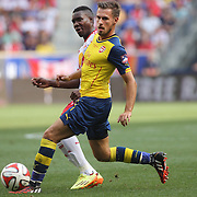 Aaron Ramsey, Arsenal, challenged by Lloyd Sam, New York Red Bulls, during the New York Red Bulls Vs Arsenal FC,  friendly football match for the New York Cup at Red Bull Arena, Harrison, New Jersey. USA. 26h July 2014. Photo Tim Clayton