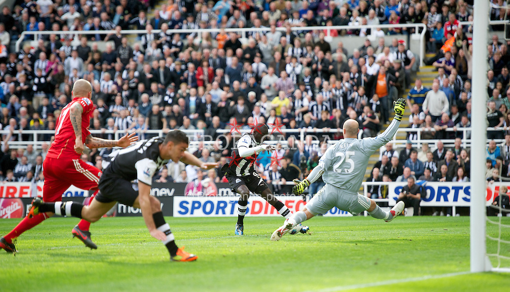 NEWCASTLE-UPON-TYNE, ENGLAND - Sunday, April 1, 2012: Newcastle United's Papiss Cisse turns inside Liverpool's goalkeeper Jose Reina to score the second goal during the Premiership match at St James' Park. (Pic by David Rawcliffe/Propaganda)