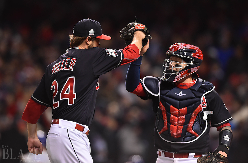 Oct 25, 2016; Cleveland, OH, USA; Cleveland Indians relief pitcher Andrew Miller (left) reacts with catcher Roberto Perez (right) after striking out Chicago Cubs catcher David Ross (not pictured) to end the top of the 7th inning in game one of the 2016 World Series at Progressive Field. Mandatory Credit: Ken Blaze-USA TODAY Sports