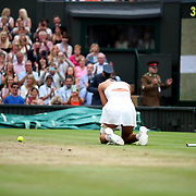 LONDON, ENGLAND - JULY 15:  Garbine Muguruza of Spain falls to her knees as the video replay confirms her victory in the Ladies Singles final against Venus Williams of The United States in the Wimbledon Lawn Tennis Championships at the All England Lawn Tennis and Croquet Club at Wimbledon on July 15, 2017 in London, England. (Photo by Tim Clayton/Corbis via Getty Images)