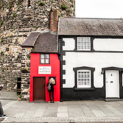Quay House, also known as the Smallest House in Great Britain, stands next to the walls of Conwy Castle. Until 1900, it was a functional but small residence but is now a tourist attraction.