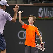 March 7, 2015, Indian Wells, California:<br /> Jagger Leach, son of Lindsay Davenport, plays a point with Andy Roddick during the McEnroe Challenge for Charity presented by Masimo in Stadium 2 at the Indian Wells Tennis Garden in Indian Wells, California Saturday, March 7, 2015.<br /> (Photo by Billie Weiss/BNP Paribas Open)