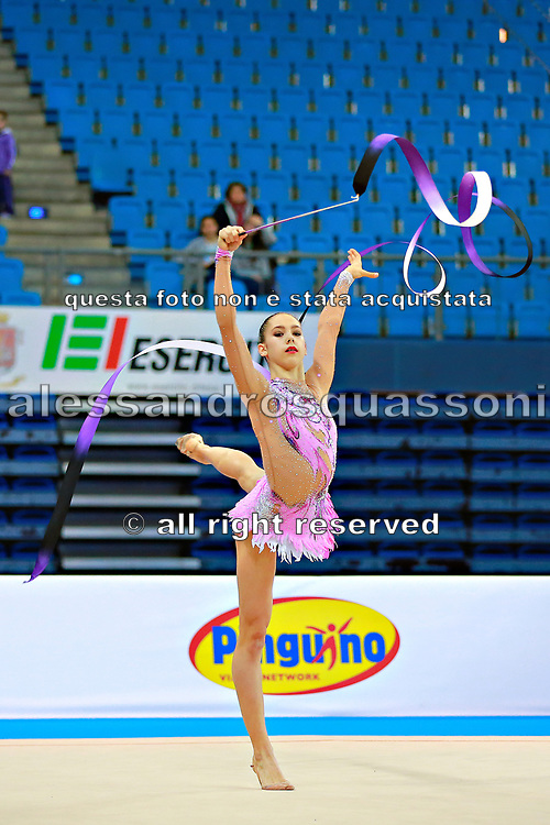 Berezina Polina during qualifying at ribbon in Pesaro World Cup 11 April 2015.<br /> Polina Berezina is a Spanish individual rhythmic gymnast of Russian origin was born in Moscow in Russia on December 5, 1997, she has been living in Spain near Alicante for some years, her team is Club Torrevieja and she is coached by Mónica Ferrández.