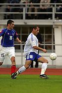 07.06.2003, Olympic Stadium, Helsinki, Finland..UEFA European Championship Qualifying match, Group 9, Finland v Serbia-Montenegro.Shefki Kuqi (Finland) v Slobodan Markovic (S&M).©Juha Tamminen