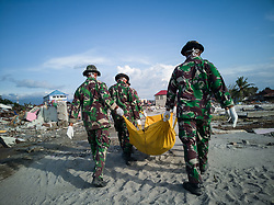 October 5, 2018 - Palu, Sulawesi, Indonesia - Evacuation of victims still going on at beach Talisha, near the beach people held pray, praying for the dead. Thousands of people died from 7.7  earthquake that triggered tsunami which destroyed thousands of houses and building near the beach and killed over 1,500 people. (Credit Image: © Donal HusniZUMA Wire)
