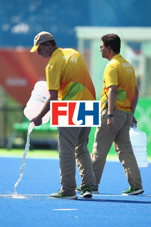 RIO DE JANEIRO, BRAZIL - AUGUST 17:  Staff pour water on the pitch during the halftime break of the womens semifinal match between the Netherlands and Germany on Day 12 of the Rio 2016 Olympic Games at the Olympic Hockey Centre on August 17, 2016 in Rio de Janeiro, Brazil.  (Photo by Mark Kolbe/Getty Images)