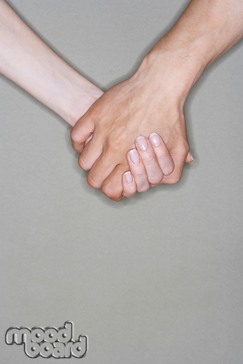 Man and woman holding hands close-up on hands
