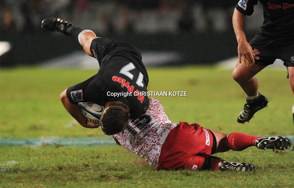 Wiehahn Herbst of the Mr Price Sharks, Rod Davies of the Reds.<br /> &copy;Backpagepix