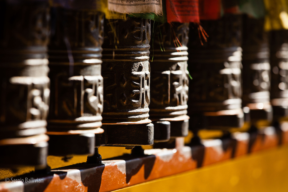 Prayer wheels shine in the morning sun, waiting for the devoted to come and spin them, thus asking for health, good luck and blessings, in Kathmandu, Nepal.
