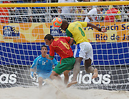 Football-FIFA Beach Soccer World Cup 2006 - Semi-final -BRA_POR -Junior Negão-BRA- header the next to Portugal's goal wathched by Alan-POR - Rio de Janeiro - Brazil 11/11/2006<br />Mandatory credit: FIFA/ Marco Antonio Rezende.