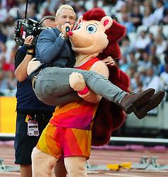 London, August 12 2017 . Hero the Hedgehog lifts Iwan Thomas on day nine of the IAAF London 2017 world Championships at the London Stadium. © Paul Davey.