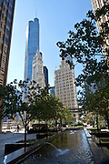 View of Trump Tower and the Wrigley Building from Pioneer Court in Chicago, IL, USA.