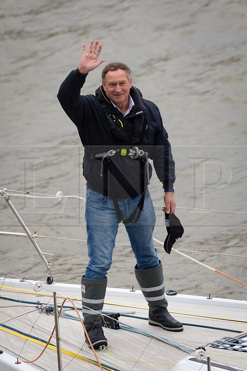 © Licensed to London News Pictures. 20/03/2019. London, UK.  Adventurer Sir David Hempleman-Adams waves before he sails his yacht, Chione underneath Tower Bridge in London to launch his attempt to sail solo to New York to raise awareness of the St John Ambulance charity.  The record-breaking 62-year-old, who inspired the likes of Bear Grylls and Ben Fogle with his fearless expeditions, says his Voyage of Discovery #DiscoverSJA will be harder than climbing Everest. Photo credit: Vickie Flores/LNP