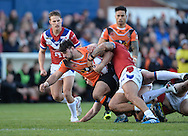 Wakefield Trinity Wildcats defence brings down Matt Cook of Castleford Tigers during the Pre-season Friendly match at Belle Vue, Wakefield<br /> Picture by Richard Land/Focus Images Ltd +44 7713 507003<br /> 15/01/2017