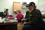 Melanie and Steve work on taxes and payroll before the workday begins. Steve serves as coffee delivery and handy man for the girls at the clinic.