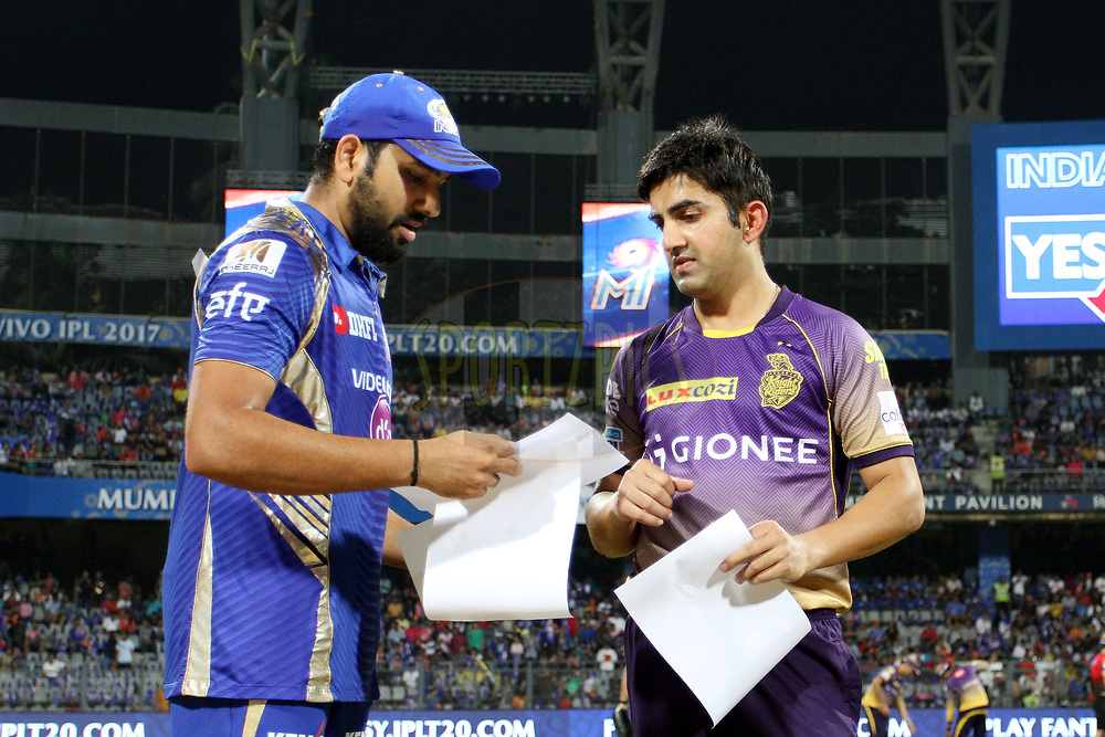 Mumbai Indians captain Rohit Sharma and Kolkata Knight Riders captain Gautam Gambhir during the toss of the match 7 of the Vivo 2017 Indian Premier League between the Mumbai Indians and the Kolkata Knight Riders held at the Wankhede Stadium in Mumbai, India on the 9th April 2017<br /> <br /> Photo by Vipin Pawar - IPL - Sportzpics