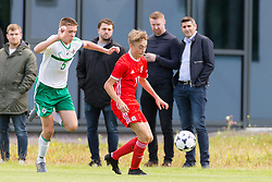 WREXHAM, WALES - Thursday, August 15, 2019: Wales' Alex Roberts and Northern Ireland's captain Ruairi McConville during the UEFA Under-15's Development Tournament match between Wales and Northern Ireland at Colliers Park. (Pic by Paul Greenwood/Propaganda)