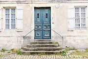 Typical street scene quaint house with weatherworn door, shutters traditional architecture, St Martin de Re, Ile de Re, France