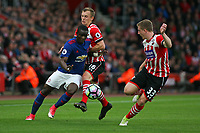 Football - 2016 / 2017 Premier League - Southampton vs. Manchester United<br /> <br /> Eric Bailly of Manchester United powers his way past Southampton's James Ward-Prowse and Southampton's Matt Targett at St Mary's Stadium Southampton<br /> <br /> COLORSPORT/SHAUN BOGGUST