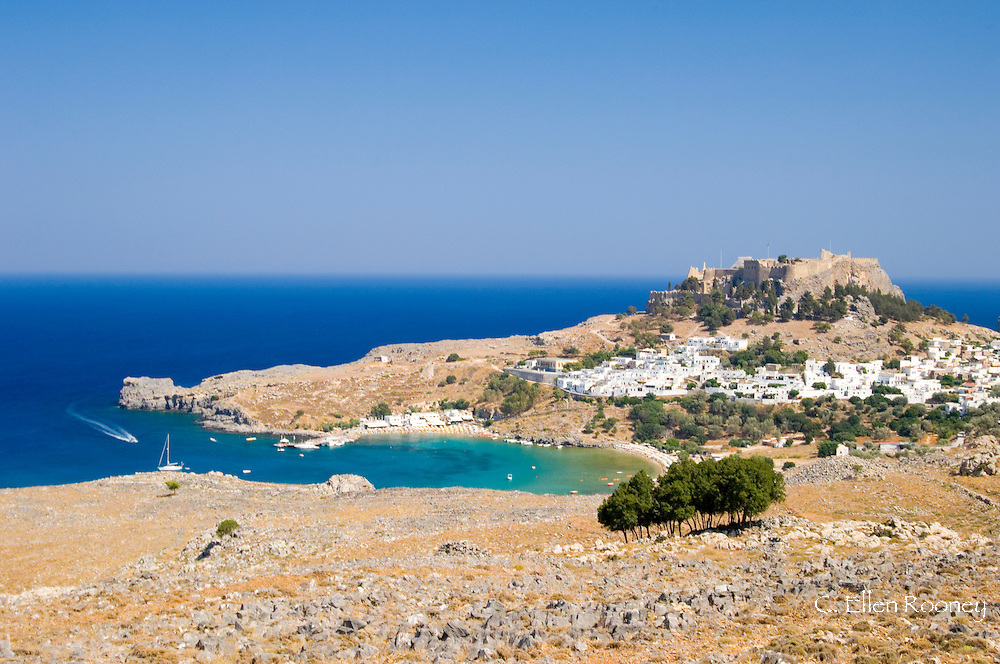 Typical Dodecanese style white houses, Lindos Bay and the Acropolis above Lindos,<br /> Rhodes, Dodecanese Islands, Greece