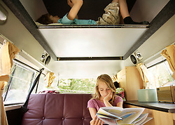 Boy and Girl in Recreational Vehicle