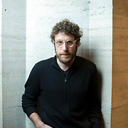 February 12, 2015 - New York, NY : Artist Dustin Yellin poses for a portrait in the David H. Koch Theater at Lincoln Center on Thursday evening. Yellin's 'Psychogeographies,' a set of 15 sculptural collages/paintings were made for New York City Ballet's 2015 Art Series. CREDIT: Karsten Moran for The New York Times