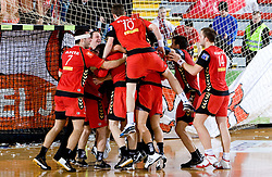 Players of Slovan celebrate during the 1/ 8 Men's European Handball Challenge Cup match between RD Slovan, Slovenia and Ystads IF, Sweden, on February 21, 2009 in Arena Kodeljevo, Ljubljana, Slovenia. Slovan defeated Ystads 37-27 and qualified to quarterfinals. (Photo by Vid Ponikvar / Sportida)