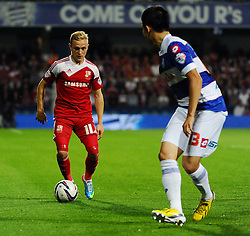 Swindon Town's Alex Pritchard takes on Queen Park Rangers' Yoon Suk-Young   - Photo mandatory by-line: Seb Daly/JMP - Tel: Mobile: 07966 386802 27/08/2013 - SPORT - FOOTBALL - Loftus Road - London - Queens Park Rangers V Swindon Town -  Capital One Cup - Round 2