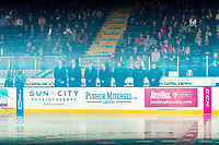 KELOWNA, CANADA - SEPTEMBER 22: Jason Smith, head coach, Kris Mallette, assistant coach, Travis Crickard, assistant coach, Adam Brown, goalie coach, Scott Hoyer, Athletic Therapist, Mitch Bain, equipment manager and Mel Garratt, assistant equipment manager of the Kelowna Rockets stand on the bench against the Kamloops Blazers on September 22, 2018 at Prospera Place in Kelowna, British Columbia, Canada.  (Photo by Marissa Baecker/Shoot the Breeze)  *** Local Caption ***