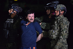 Jan. 8, 2016 - Mexico, Distrito Federal, MEXICO - Joaquin ''El Chapo'' Guzman faces the press as he is escorted to a helicopter in handcuffs by Mexican soldiers and marines at a federal hangar in Mexico City, Mexico, Friday  January. 8, 2016.  ANTONIO NAVA/PI (Credit Image: © Prensa Internacional via ZUMA Wire)