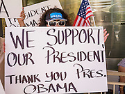 15 JUNE 2012 - PHOENIX, AZ: A woman in Phoenix shows her support for President Obama's immigration announcement Friday. President Barrack Obama announced Friday that fffective immediately, young people who were brought to the US through no fault of their own as children and who meet certain criteria will be eligible to receive deferred action for a period of 2 years and that period will be subject to renewal. The announcement of the new executive order means that up to 800,00 young undocumented immigrants will not be deported and can continue their education in the US. The move was seen by many in the immigrant community as the closest thing they would get to seeing the DREAM Act passed in the near future.       PHOTO BY JACK KURTZ