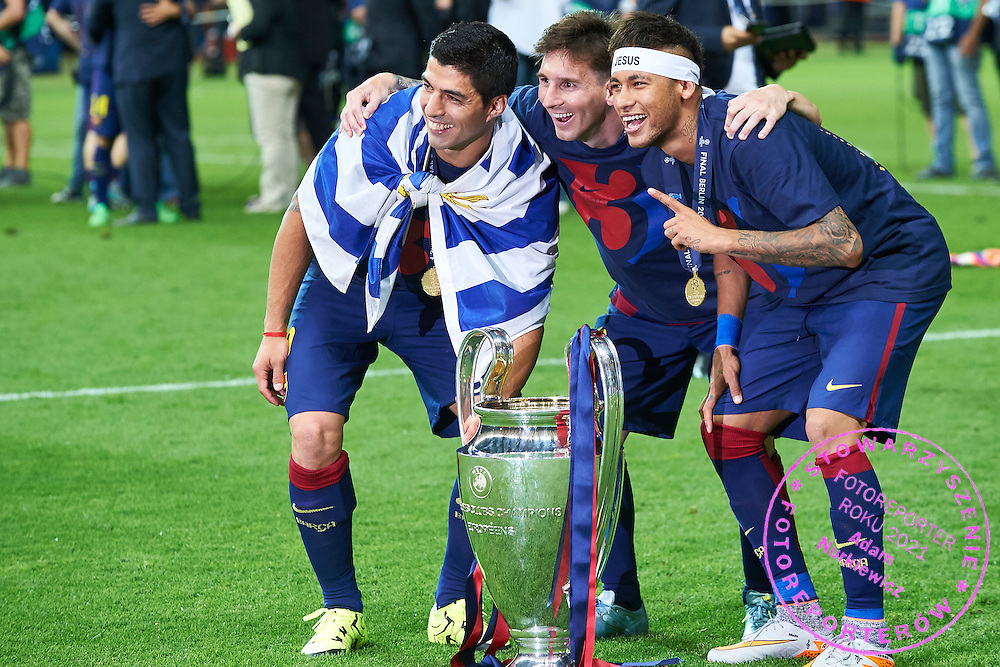 (L-R) Luis Suarez and Lionel Messi and Neymar all of FC Barcelona pose with the trophy after winning game during the 2014/15 UEFA Champions League Final between Juventus and FC Barcelona at Olympiastadion on June 6, 2015 in Berlin, Germany.<br /> Germany, Berlin, June 6, 2015<br /> <br /> Picture also available in RAW (NEF) or TIFF format on special request.<br /> <br /> For editorial use only. Any commercial or promotional use requires permission.<br /> <br /> Adam Nurkiewicz declares that he has no rights to the image of people at the photographs of his authorship.<br /> <br /> Mandatory credit:<br /> Photo by &copy; Adam Nurkiewicz / Mediasport