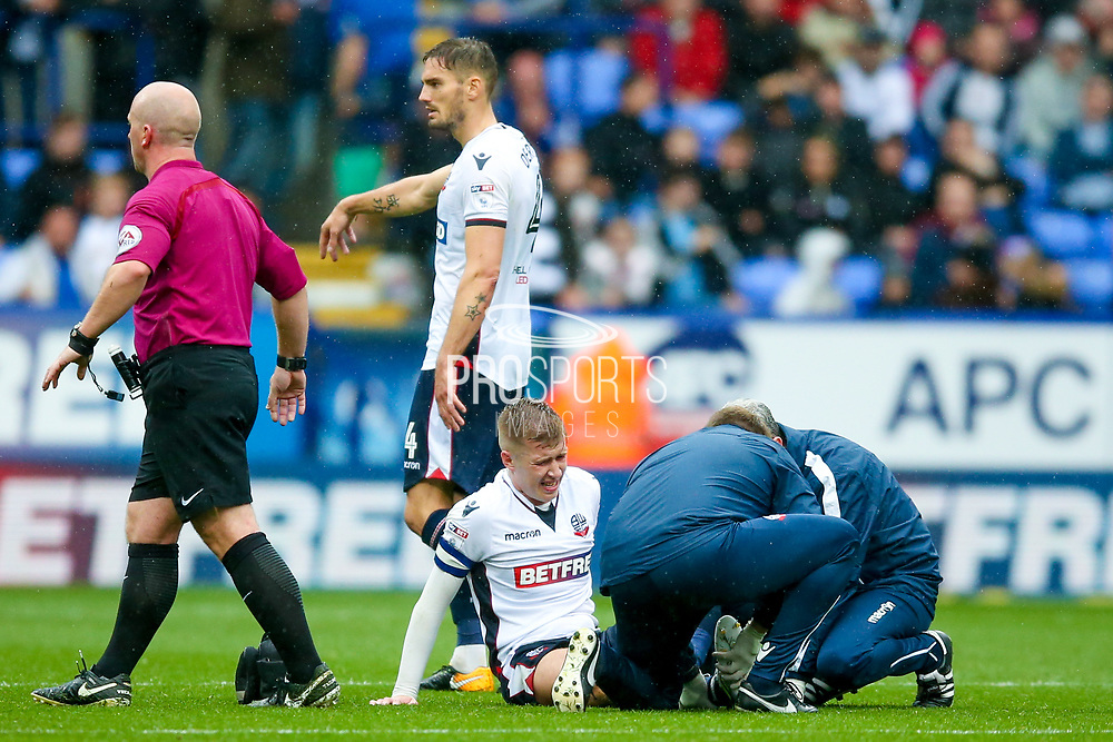 Bolton Wanderers midfielder Josh Vela (6) is in agony and has to be stretchered off during the EFL Sky Bet Championship match between Bolton Wanderers and Leeds United at the Macron Stadium, Bolton, England on 6 August 2017. Photo by Simon Davies.