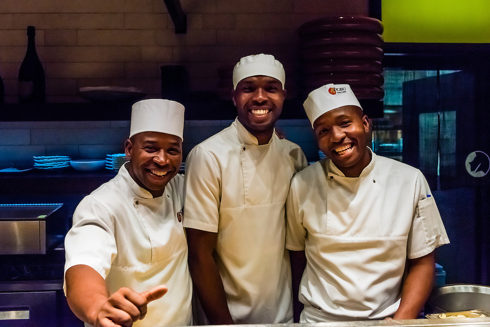Sushi chefs, at Nobu Restaurant, Cape Town, South Africa. There are 22 Nobu locations around the world. The original is in Beverly Hills, California.