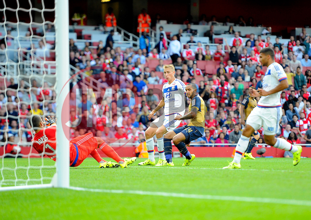 Theo Walcott of Arsenal sees his shot saved by Anthony Lopes of Lyon  - Mandatory by-line: Joe Meredith/JMP - 25/07/2015 - SPORT - FOOTBALL - London,England - Emirates Stadium - Arsenal v Lyon - Emirates Cup