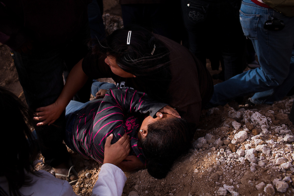 A woman screams at the funeral of two women who were shot at a masacre in Ciudad Juarez that left 13 dead and over a dozen wounded. Most of the victims were between the ages of 14 and 20 years old and were attending a birthday party.