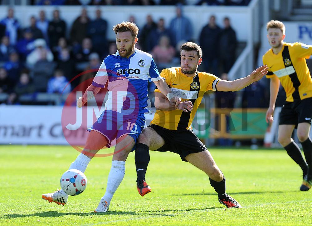 Bristol Rovers' Matty Taylor is challenged by Southport's Luke George - Photo mandatory by-line: Neil Brookman/JMP - Mobile: 07966 386802 - 11/04/2015 - SPORT - Football - Bristol - Memorial Stadium - Bristol Rovers v Southport - Vanarama Football Conference